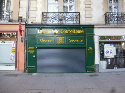 devanture Enseigne peintes à Rennes armurerie
